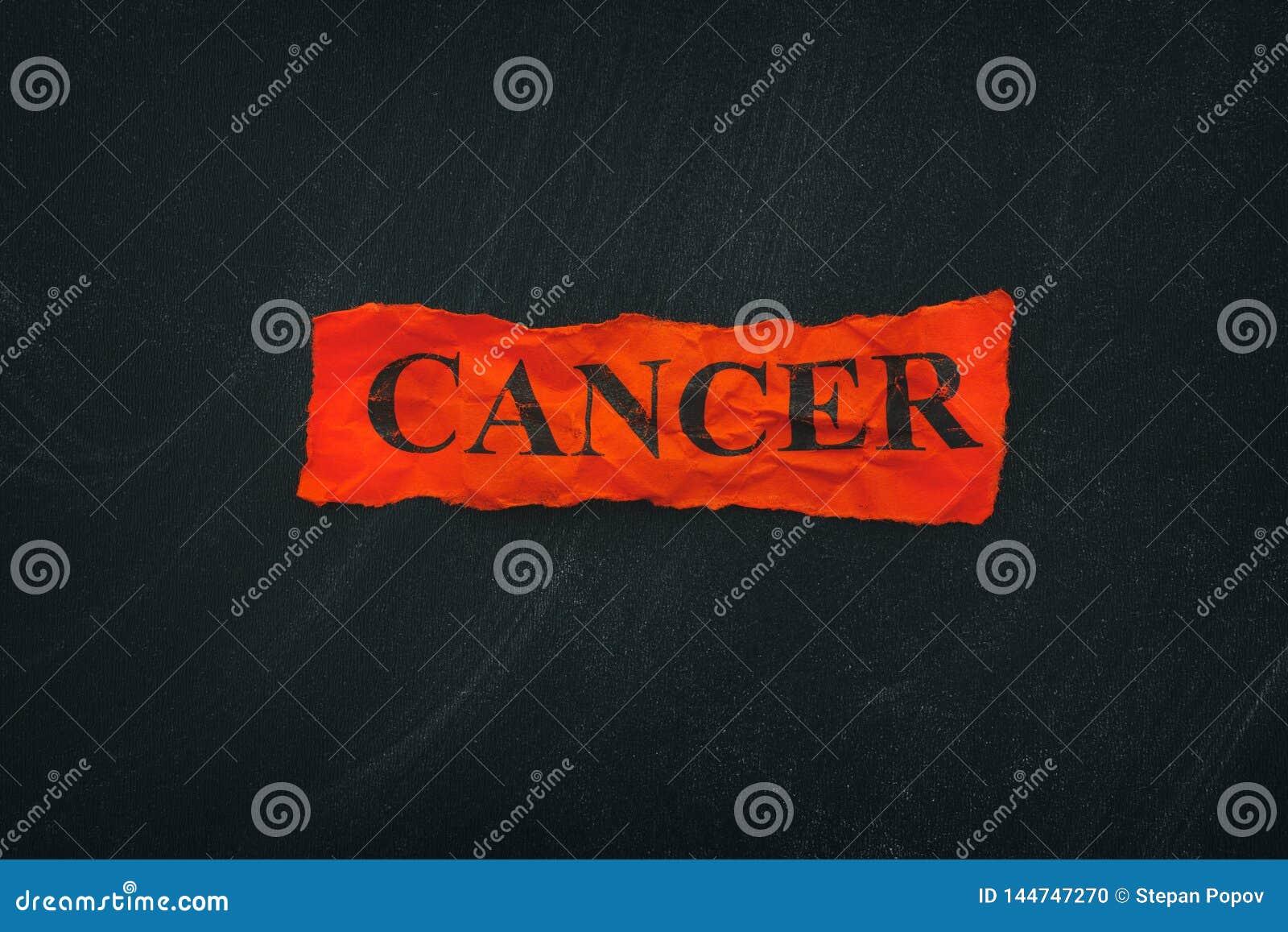 Word Kanker op rood gescheurd stuk van document