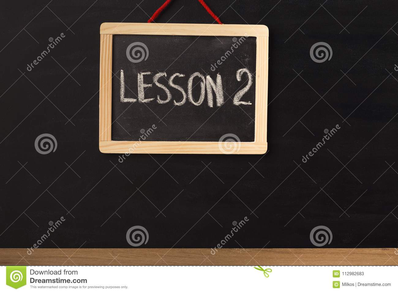 Word lesson 2 written on miniature chalkboard