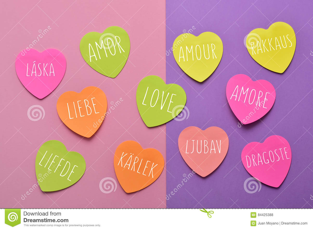Some Heart Shaped Sticky Notes Of Different Colors With The Word Love Written In Different Languages Such As Spanish Portuguese Italian French