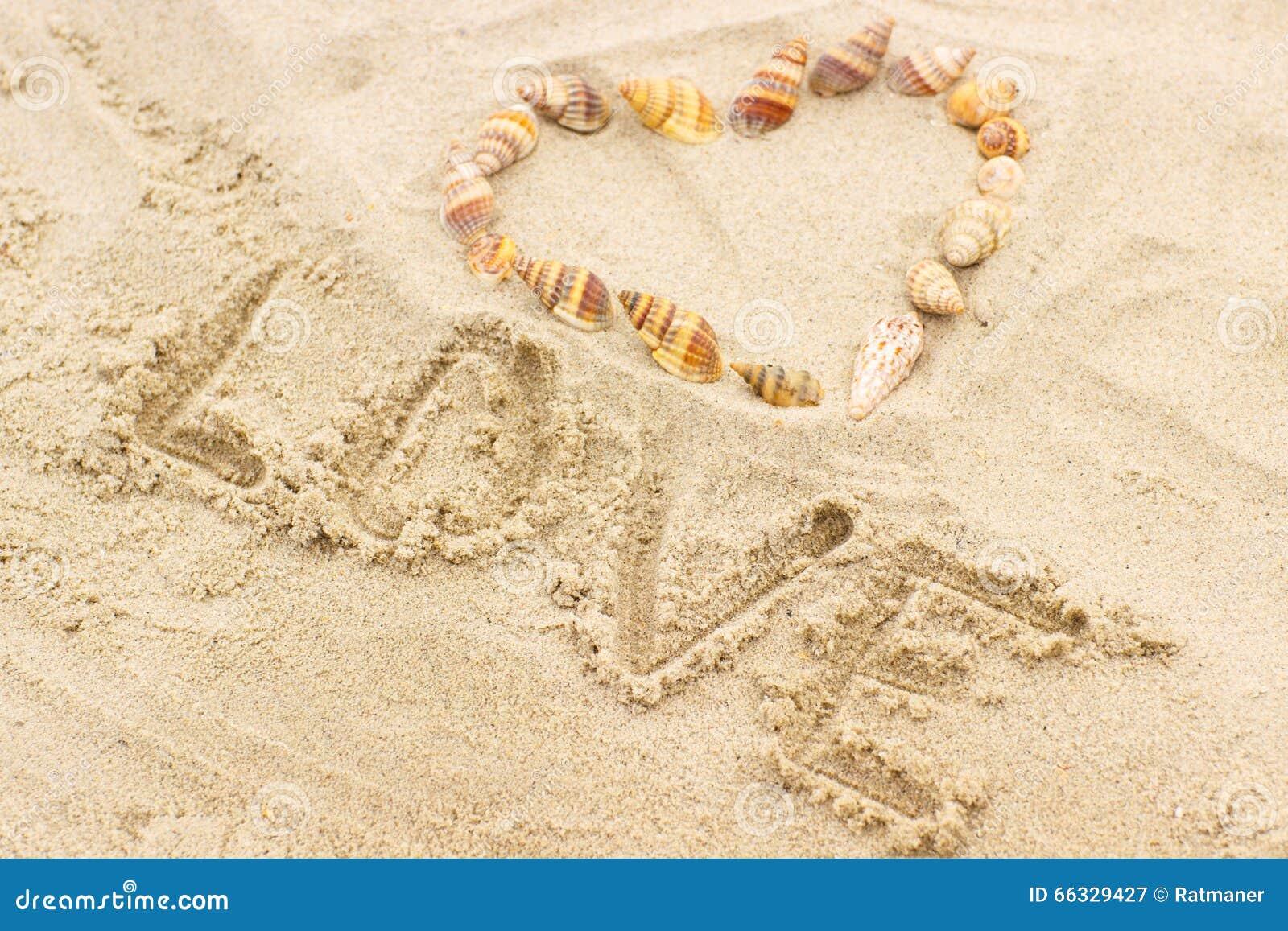 Eu Te Amo Escrito Na Areia Imagens De Stock Royalty Free: Word Love Written On Sand At The Beach, Heart Of Shells