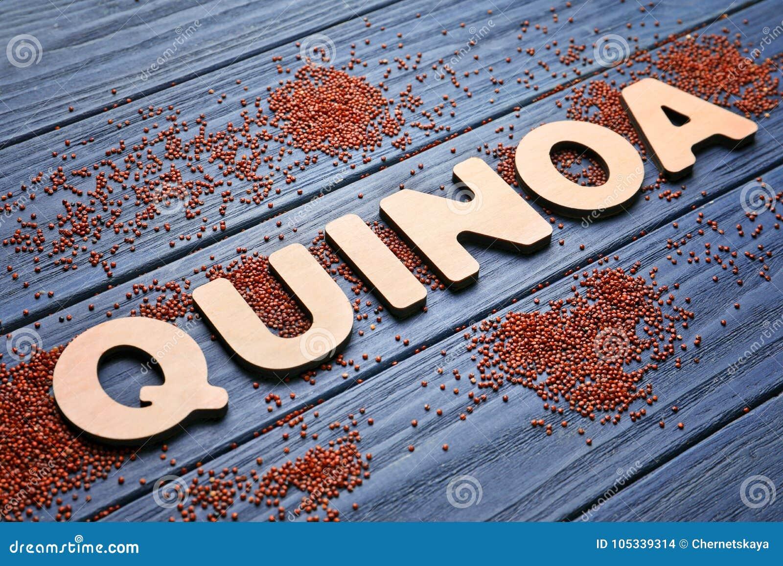 Word QUINOA van houten brieven en zaden wordt gemaakt dat