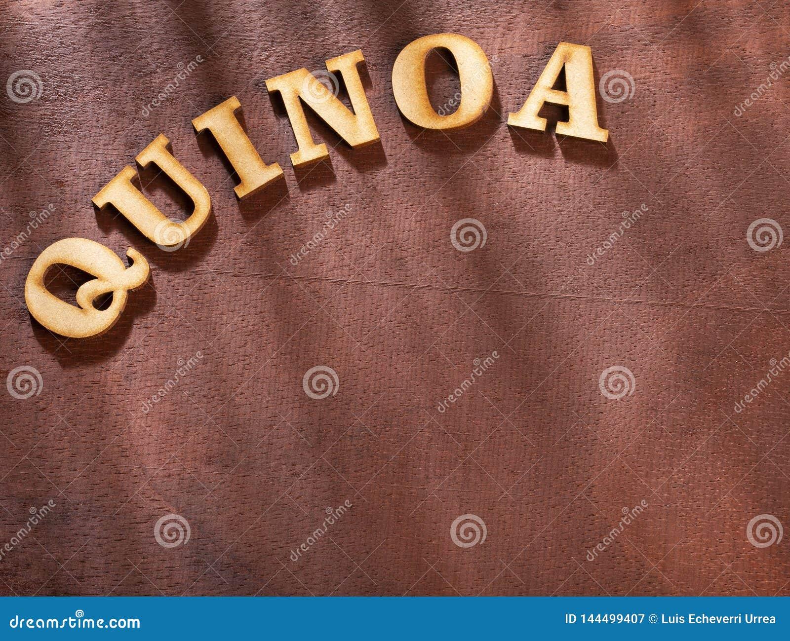 The word quinoa in wooden letters - Chenopodium quinoa. Text space