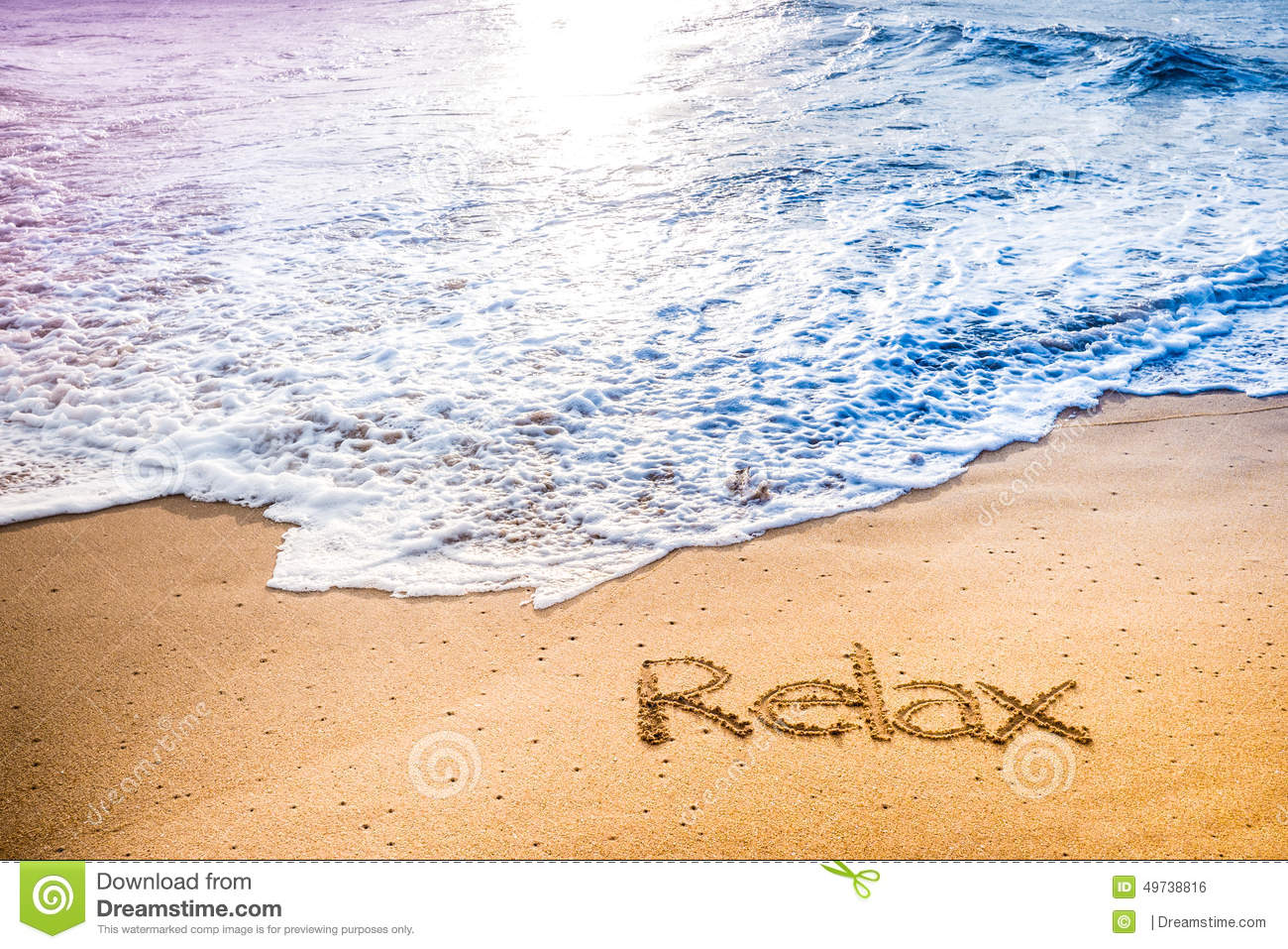 The word RELAX written into the sand