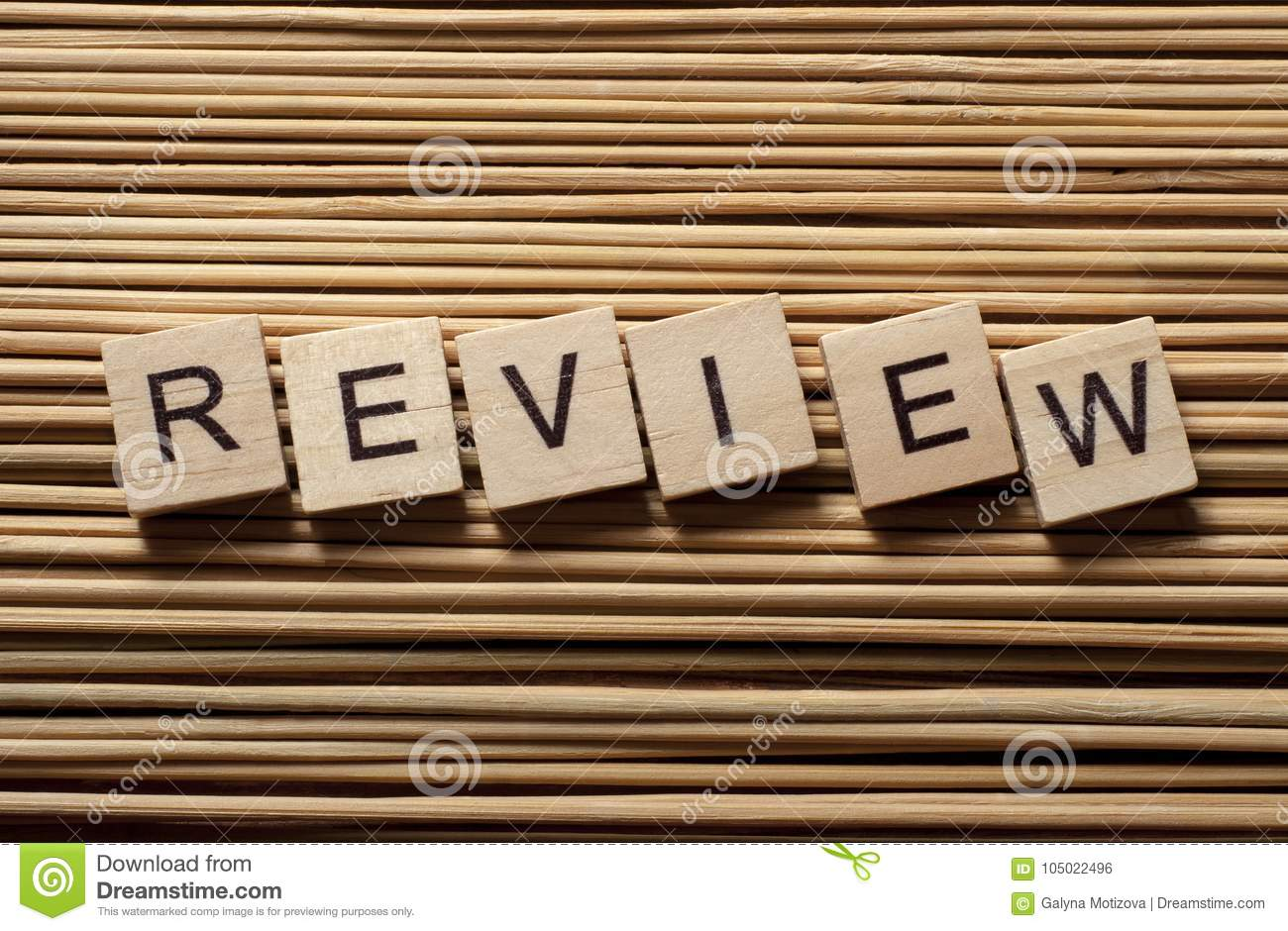 Word Review On Wood Abc Cubes At Wooden Background Stock Photo