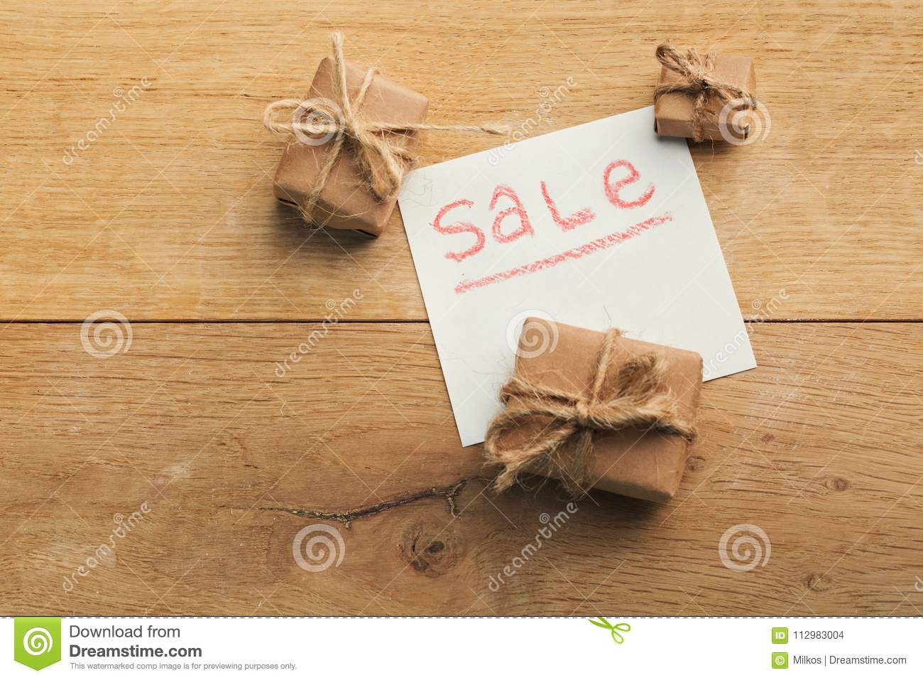 Word sale on label on wooden background top view