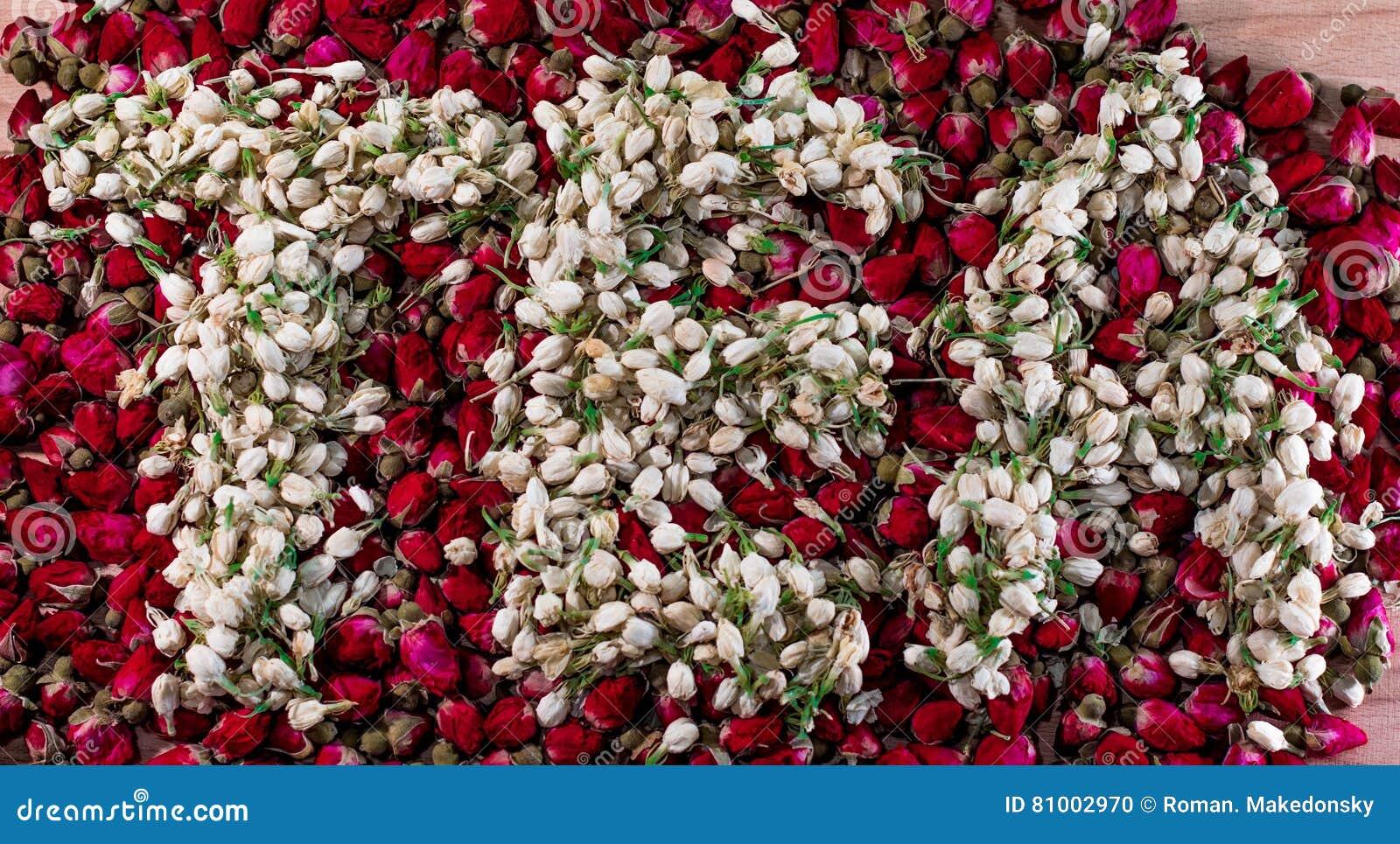Word tea made of dried jasmine flower buds over the pile of red buds dried flower jasmine dhlflorist Gallery