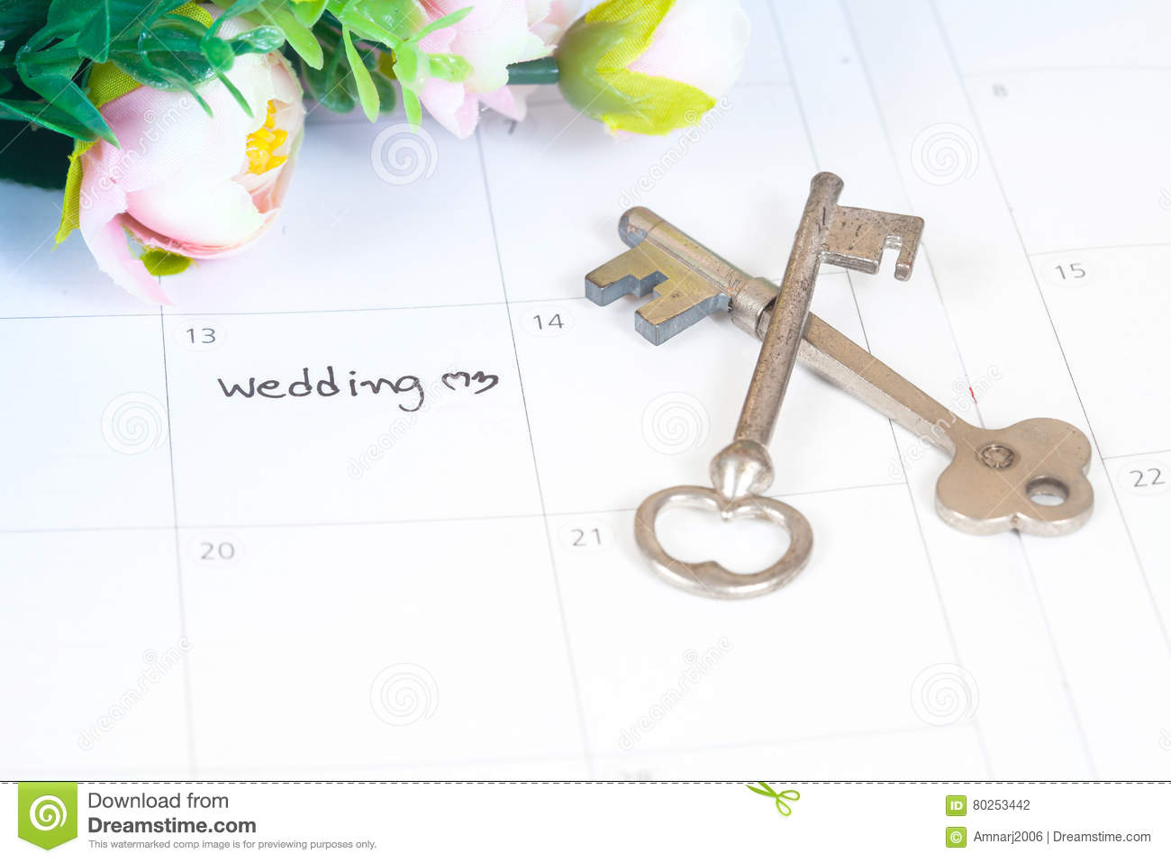 Word wedding on calendar with flowers and old key
