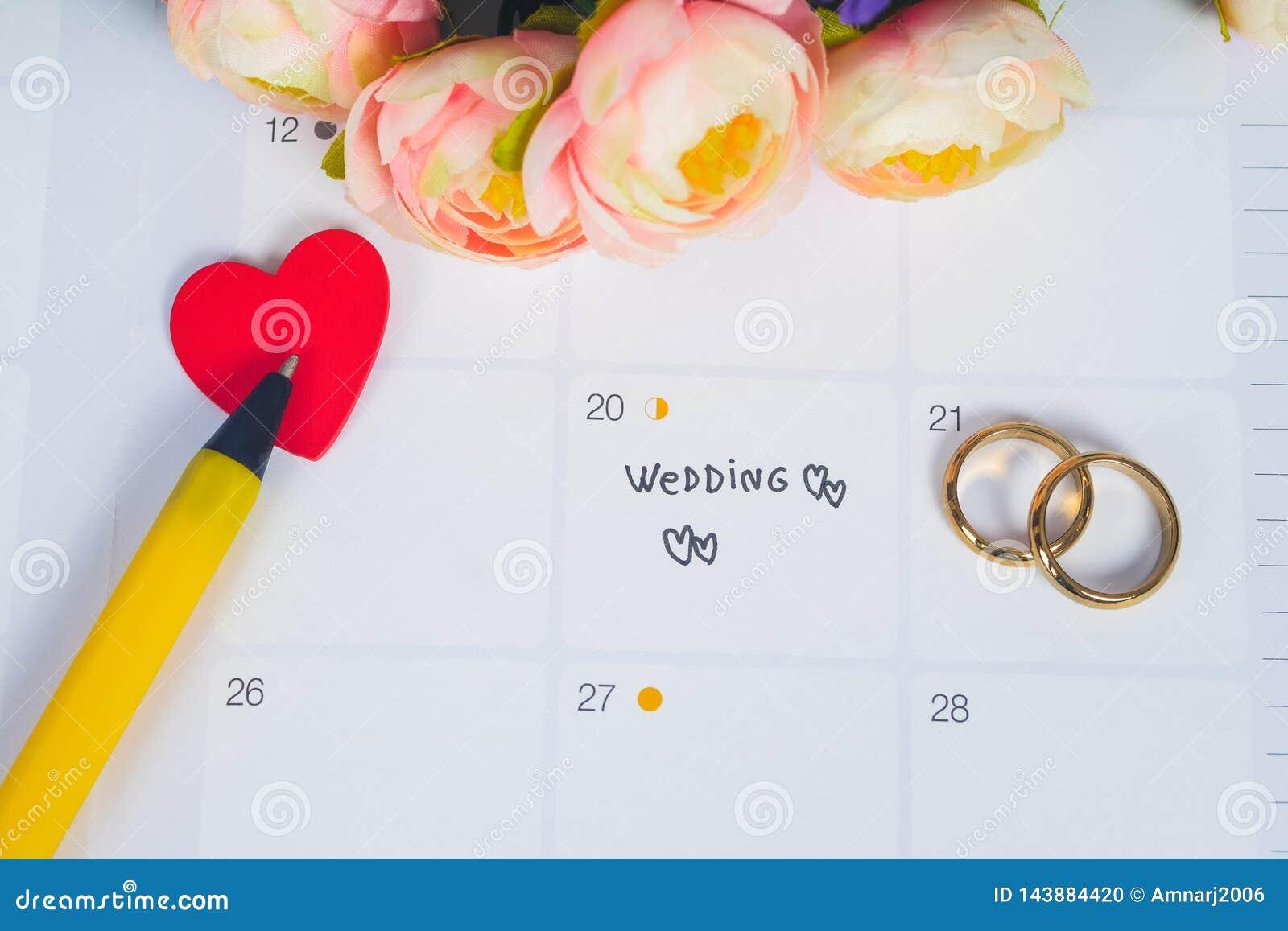 Word Wedding to Reminder Wedding day with Wedding ring on calendar planning