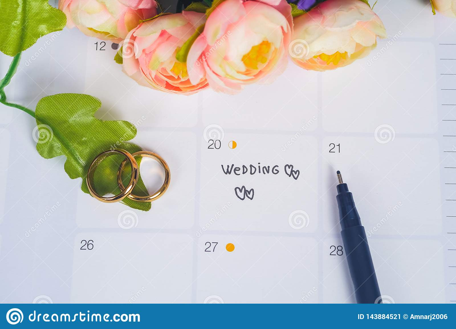 Word Wedding to Reminder Wedding day with Wedding ring on calendar planning
