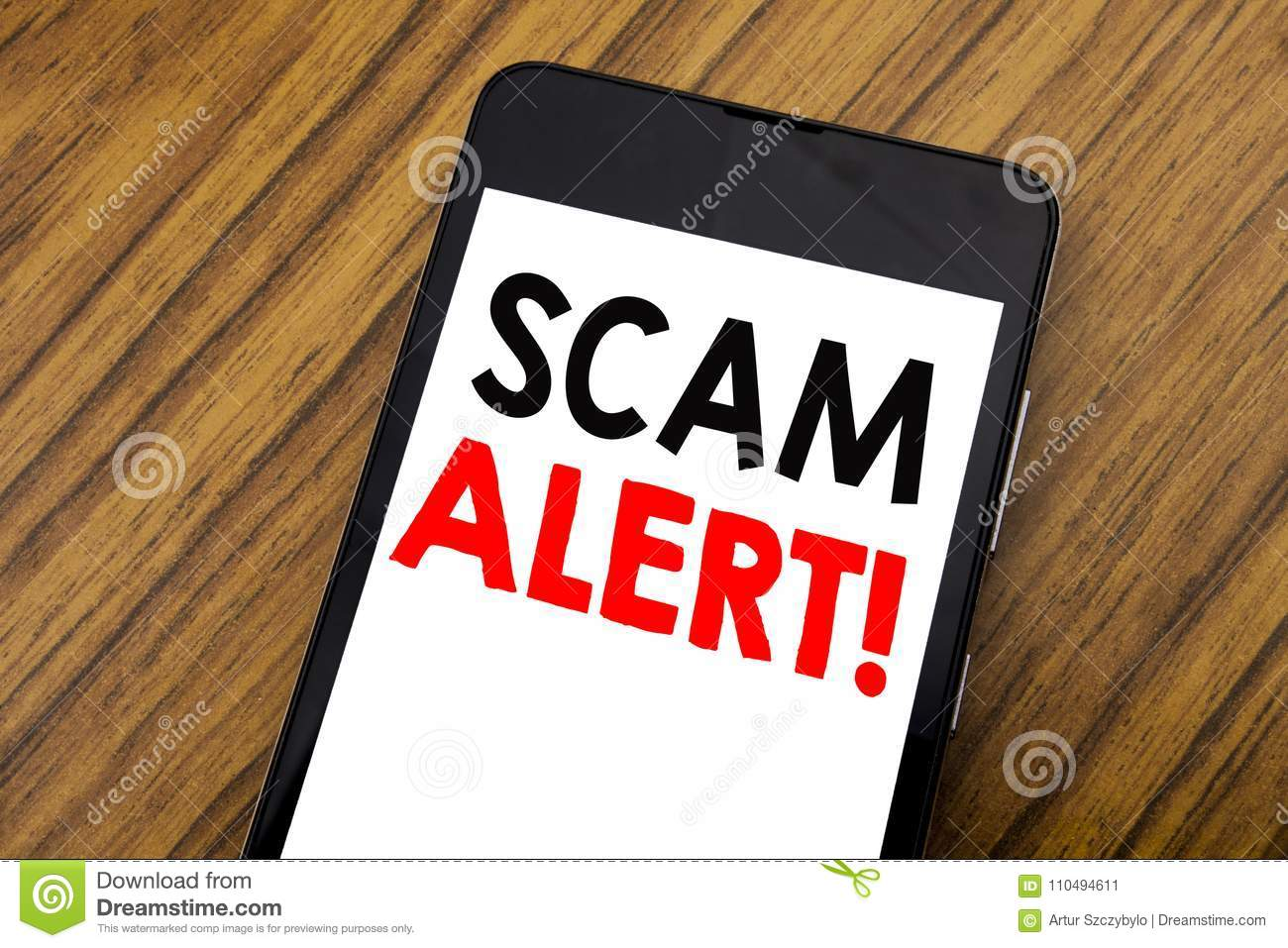 Word, writing handwriting Scam Alert. Business concept for Fraud Warning Written on mobile phone cellphone, wooden background with