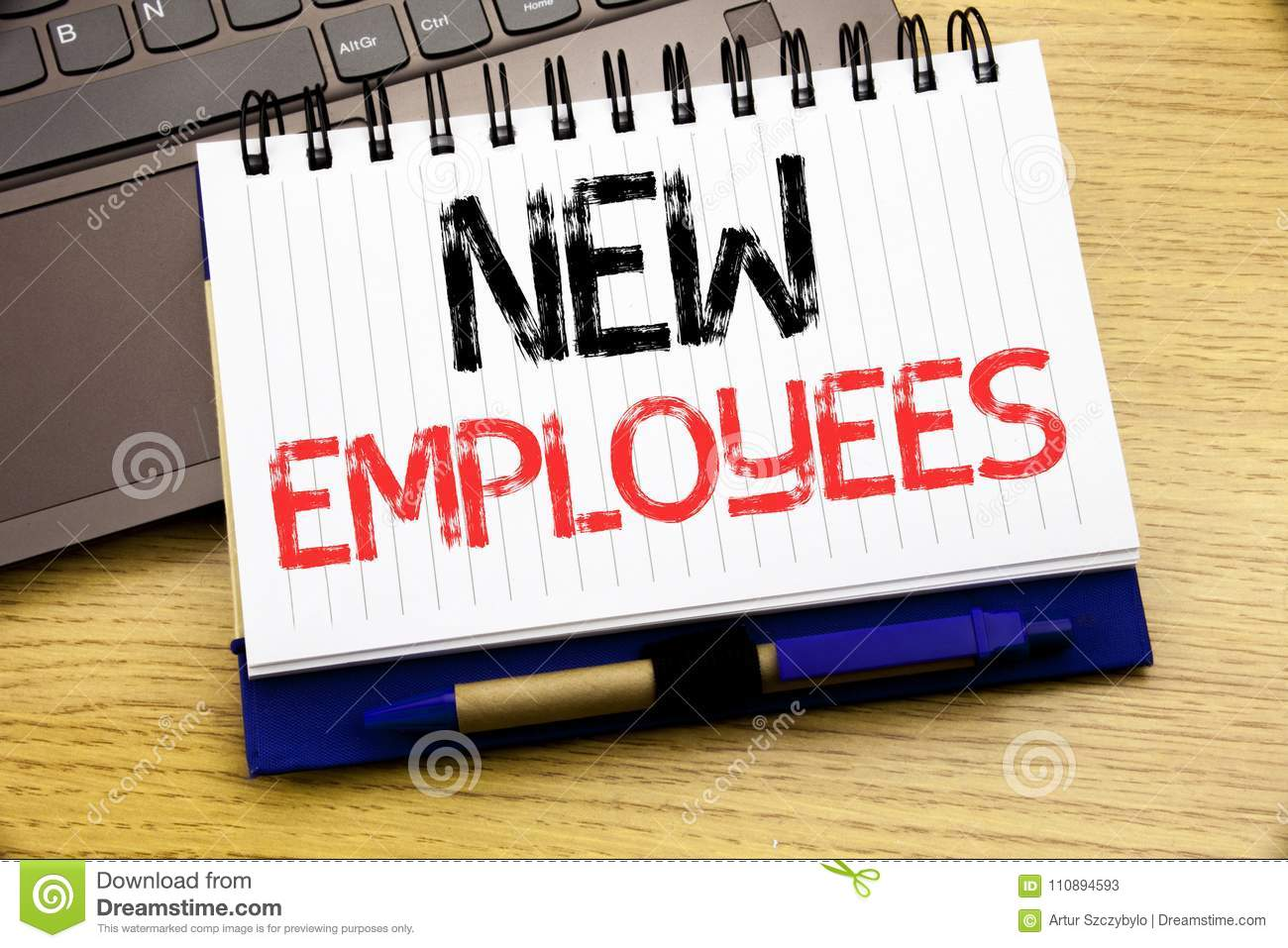 Word, writing New Employees. Business concept for Welcome Staf Recruiting written on notebook book on the wooden background in the