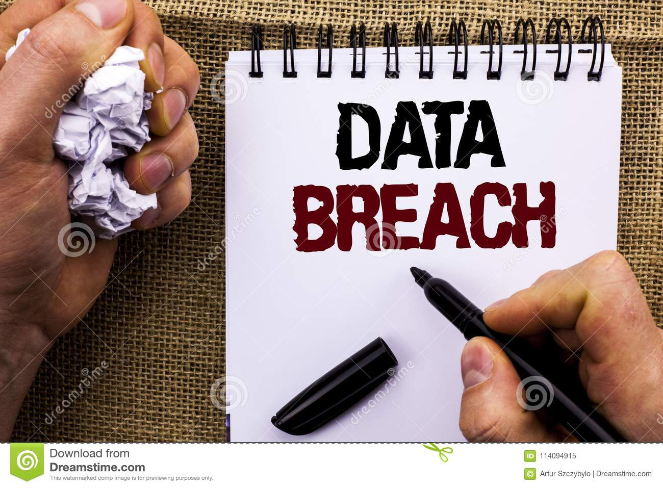 Word writing text Data Breach. Business concept for Stolen Cybercrime Information Hacking Security Malicious Crack written by Man