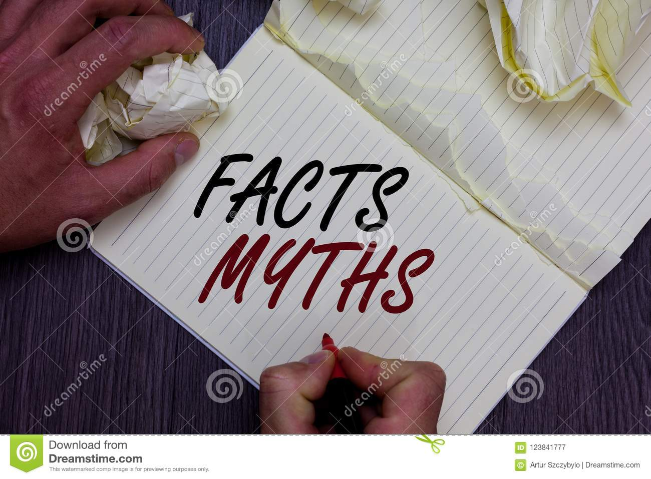 Word writing text Facts Myths. Business concept for work based on imagination rather than on real life difference Man holding mark