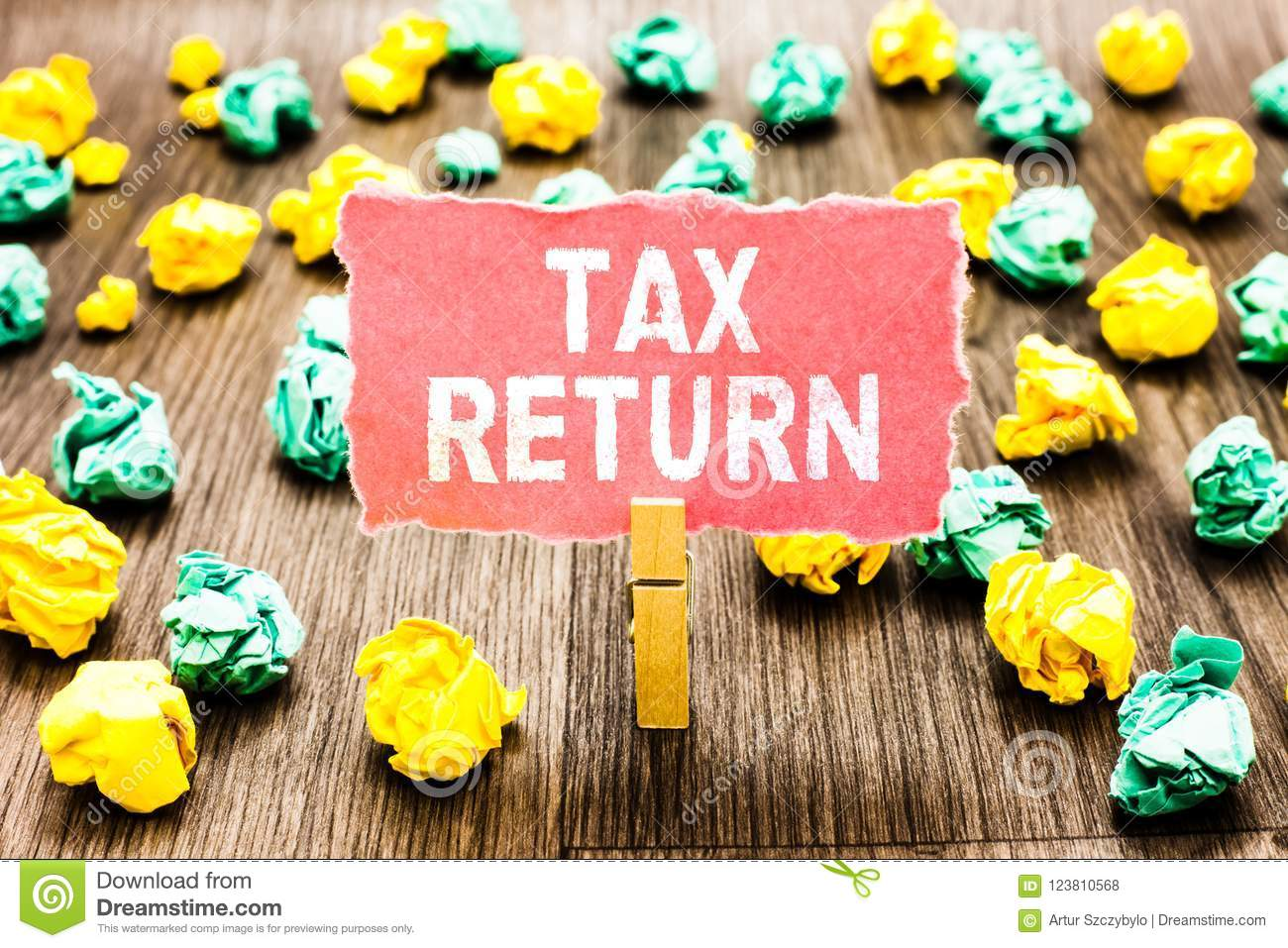 Word writing text Tax Return. Business concept for which taxpayer makes annual statement of income circumstances Clothespin holdin