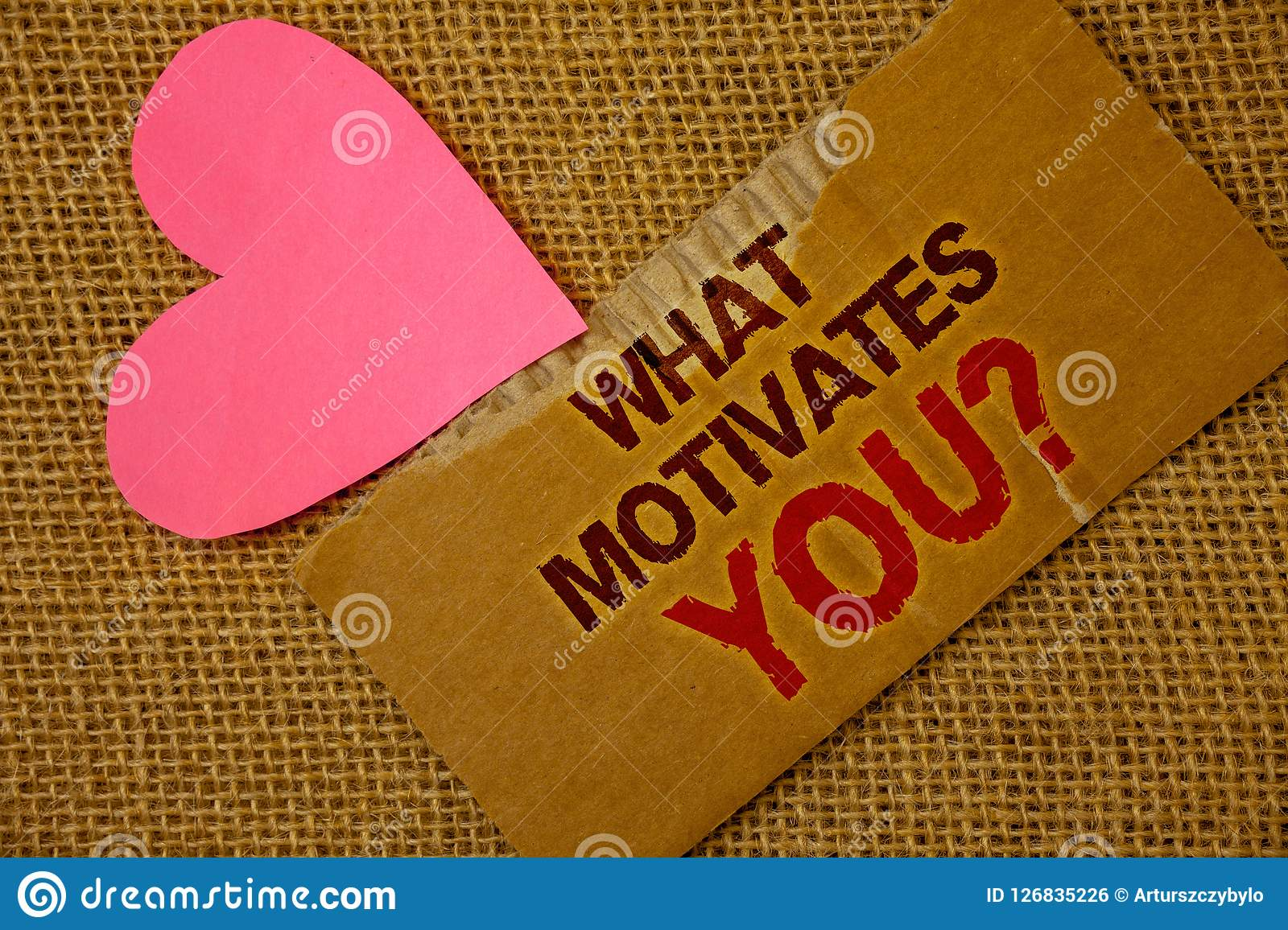 Word writing text What Motivates You Question. Business concept for Passion Drive Incentive Dream Aspiration Torn thick paper bloo
