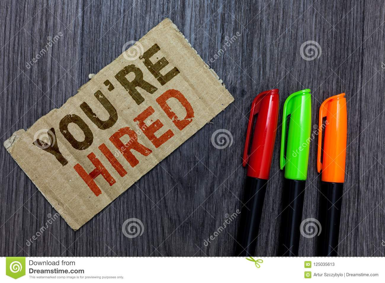 Word writing text You re are Hired. Business concept for New Job Employed Newbie Enlisted Accepted Recruited Paperboard Important