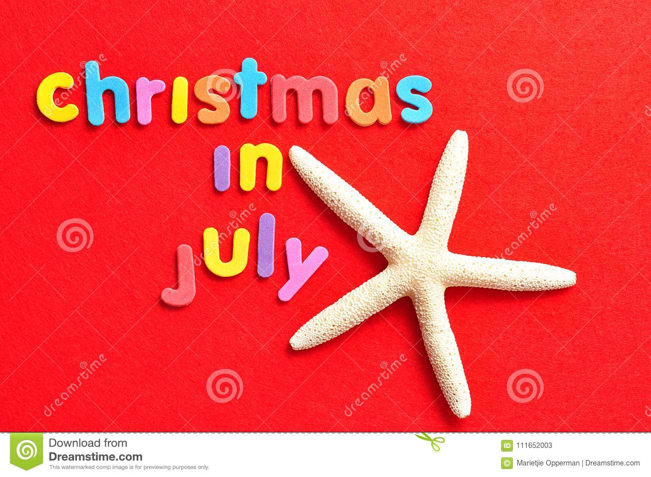 Christmas In July Background Images.The Words Christmas In July On A Red Background With A