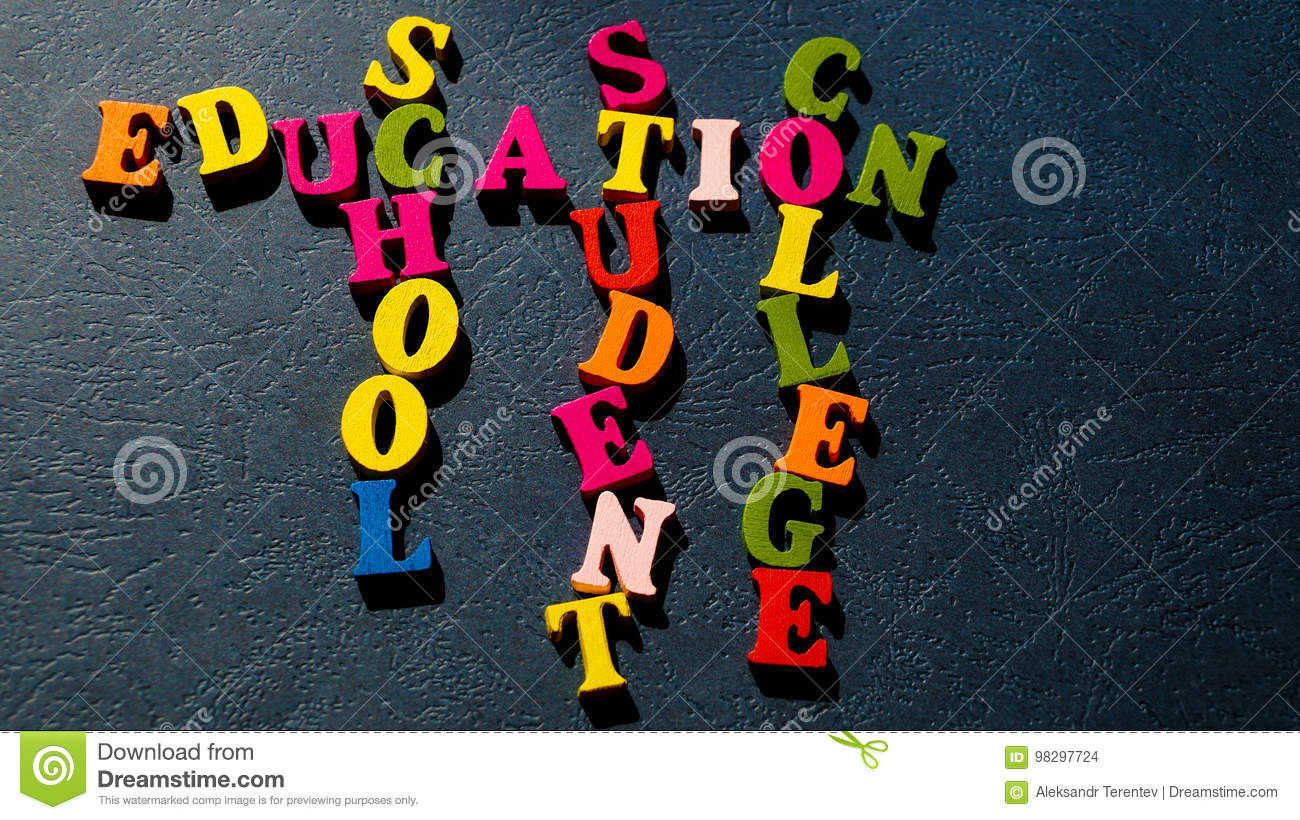 The words Education, School, Student, College built of colorful wooden letters on a dark table.