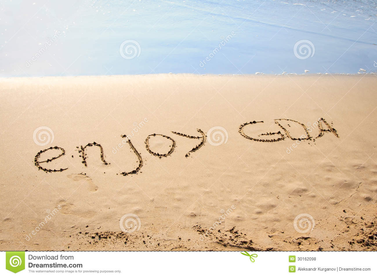 The Words Enjoy Goa Written In The Sand Stock Photo Image Of