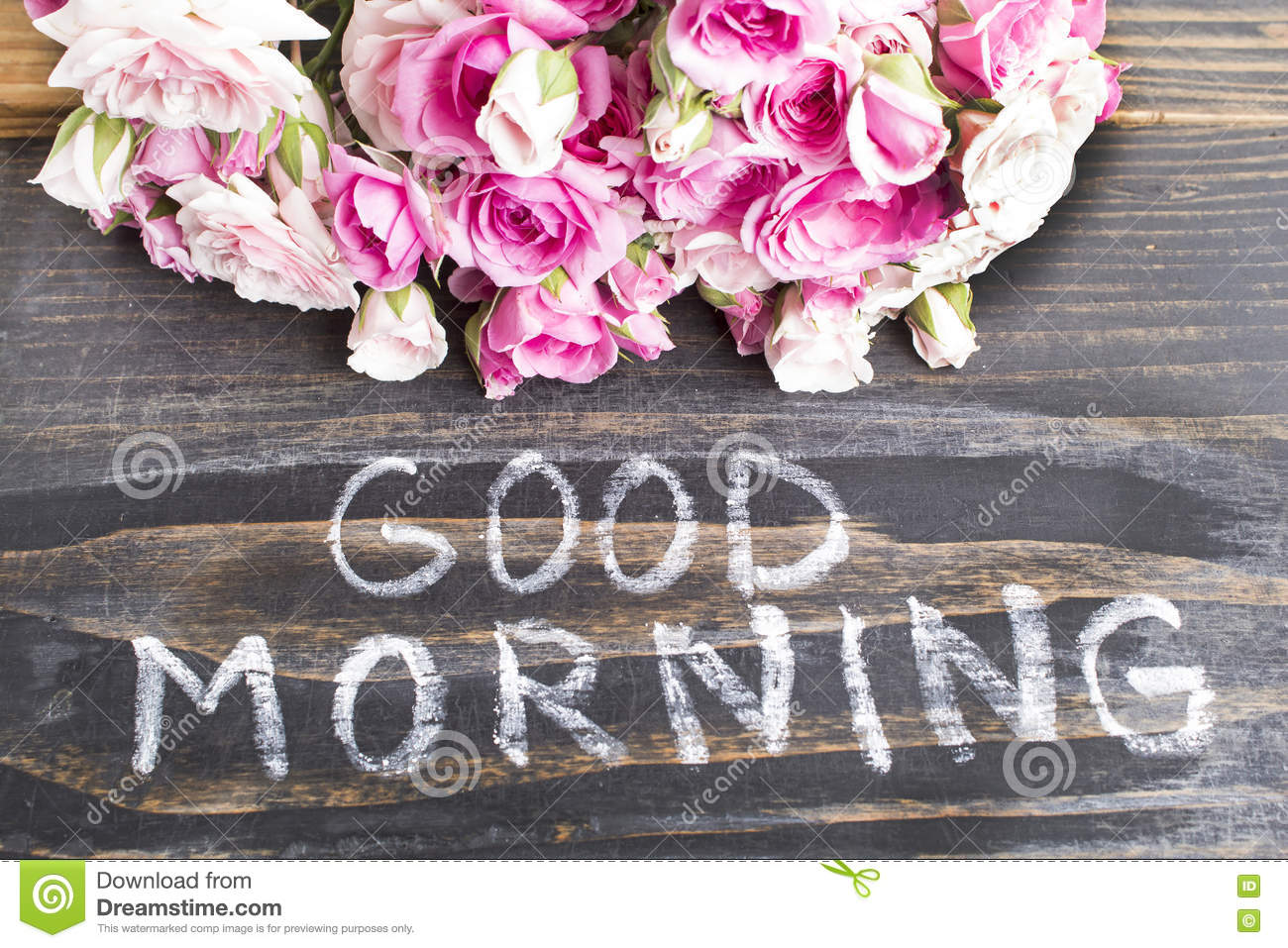 Words Good Morning With Pink Roses On A Rustic Wooden Background
