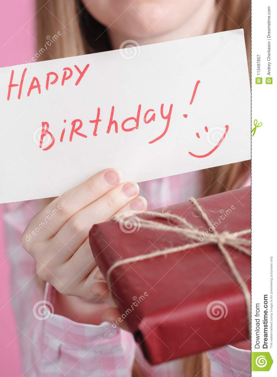words happy birthday and gift box in female hands stock image
