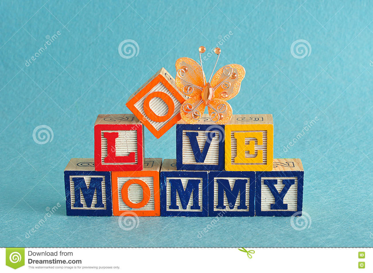 the words love mommy spelled with alphabet blocks stock photo