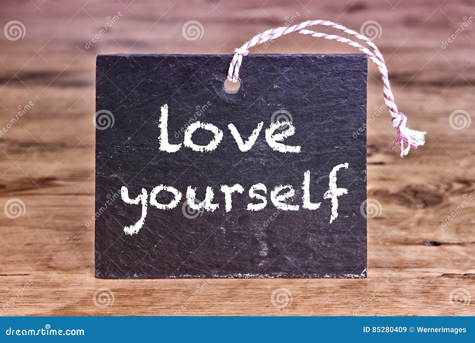 The words Love Yourself written on chalk board