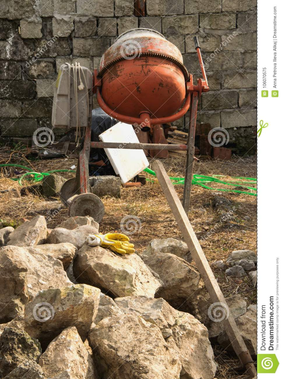Work in the construction site with the cement mixer