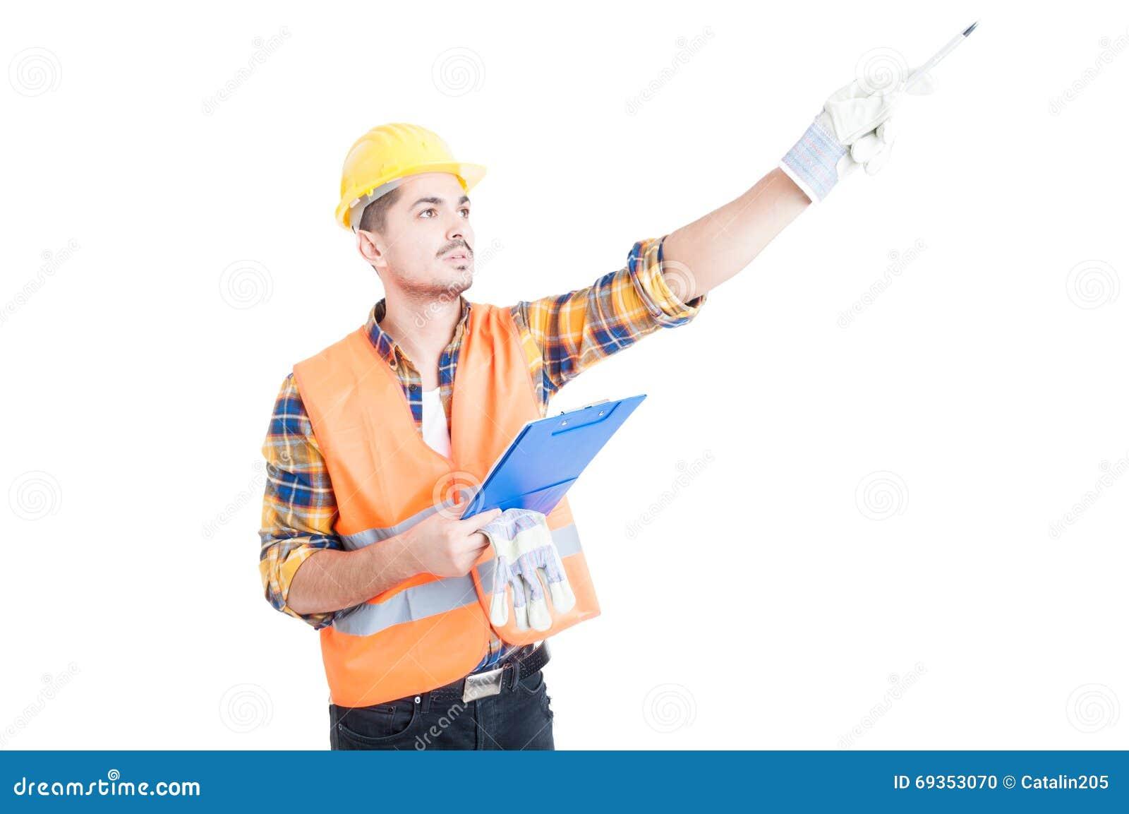 Builder Holding Up Pen Stock Photo