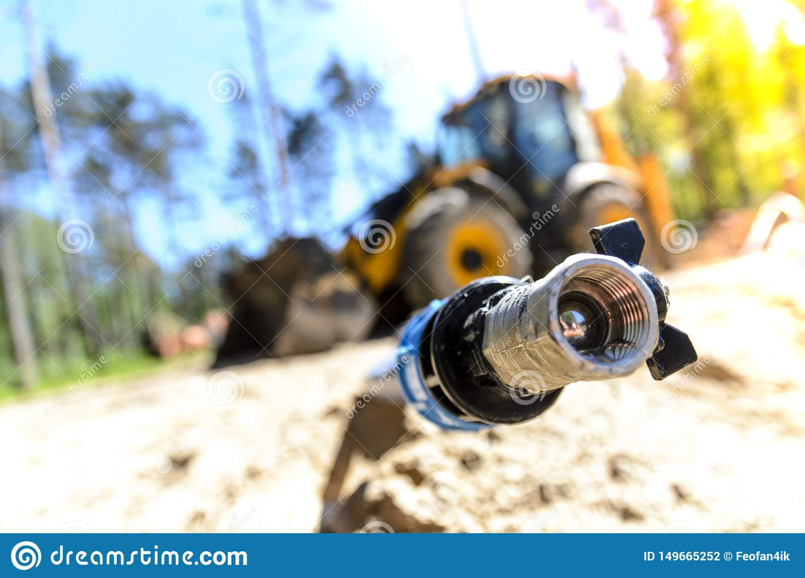 The work of a large two-wheeled tractor when laying water supply for water supply of private homes. the concept of building a coun