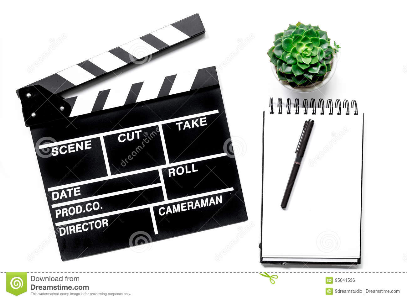Work table of producer. Movie clapperboard and notebook on white background top view