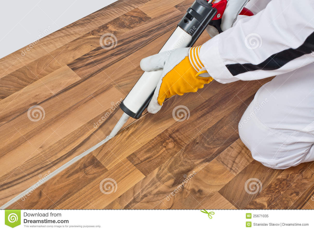 Worker Applies Silicone Sealant On Wooden Floor Stock