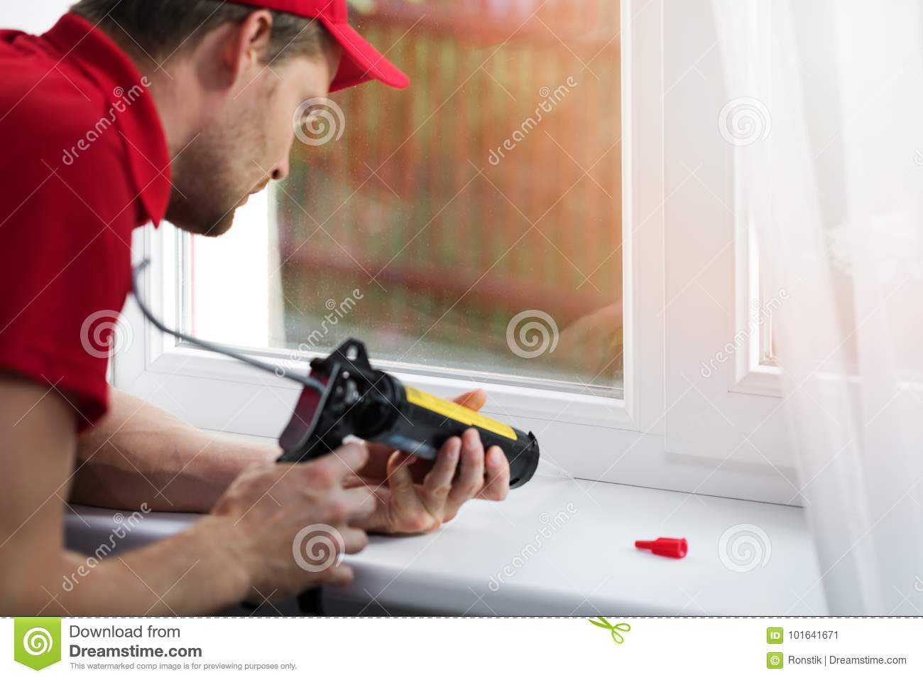 Worker Applying Silicone Sealant Under Window Frame Stock Image