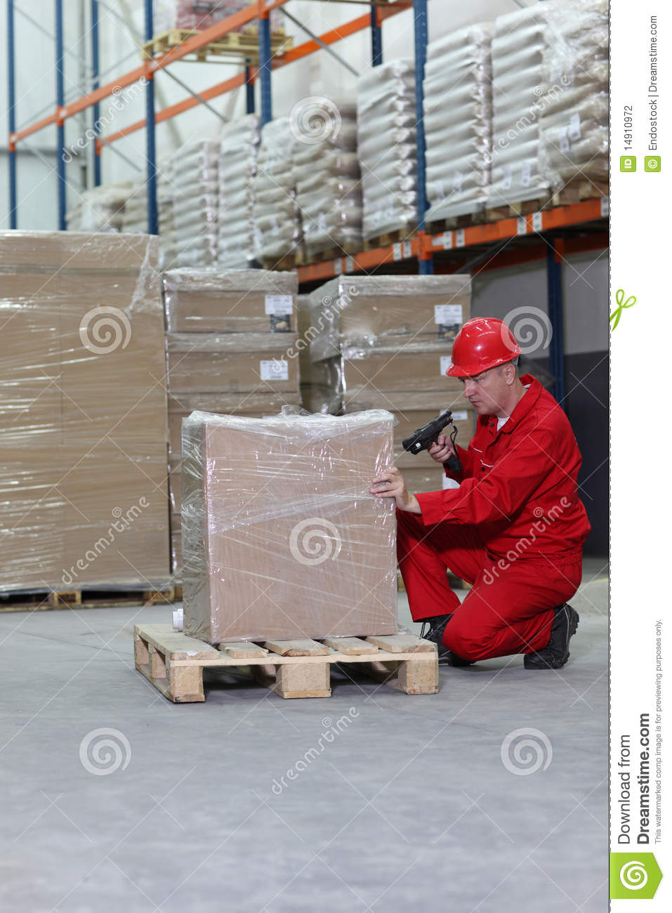 Worker with bar code reader working in warehouse