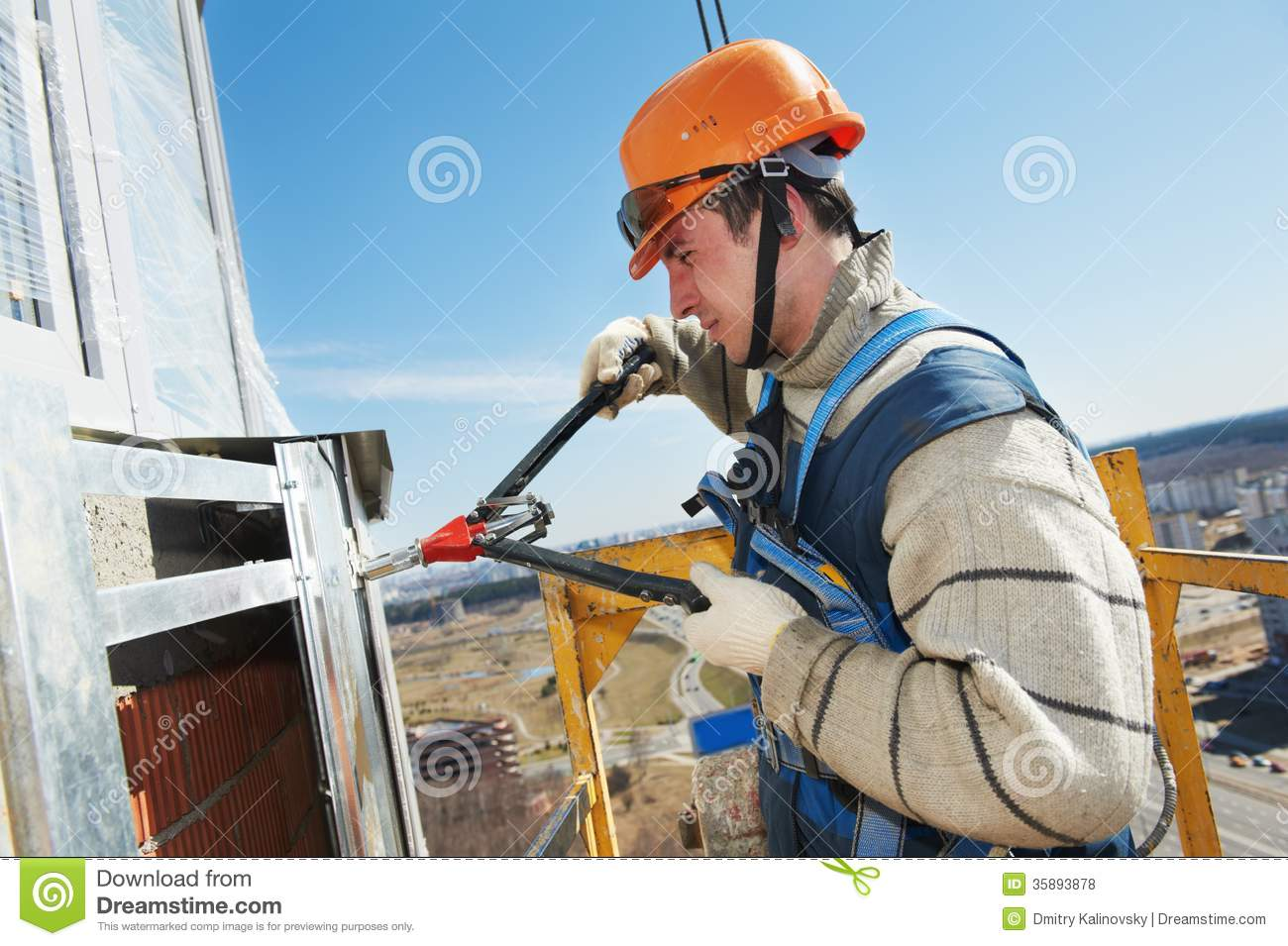Worker Builders At Facade Tile Installation Royalty Free