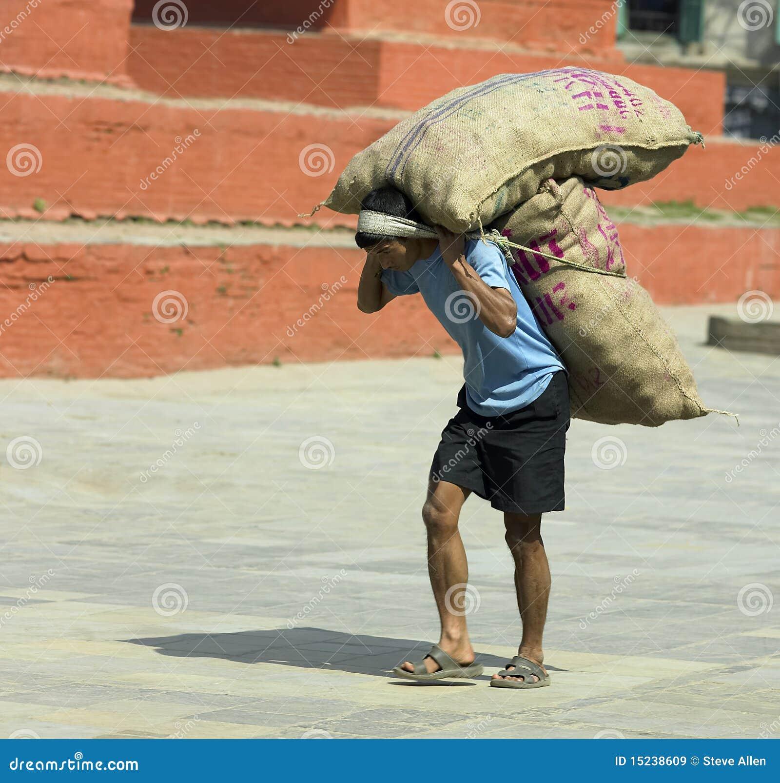 Worker Carrying A Heavy Load - Kathmandu Editorial Stock ...