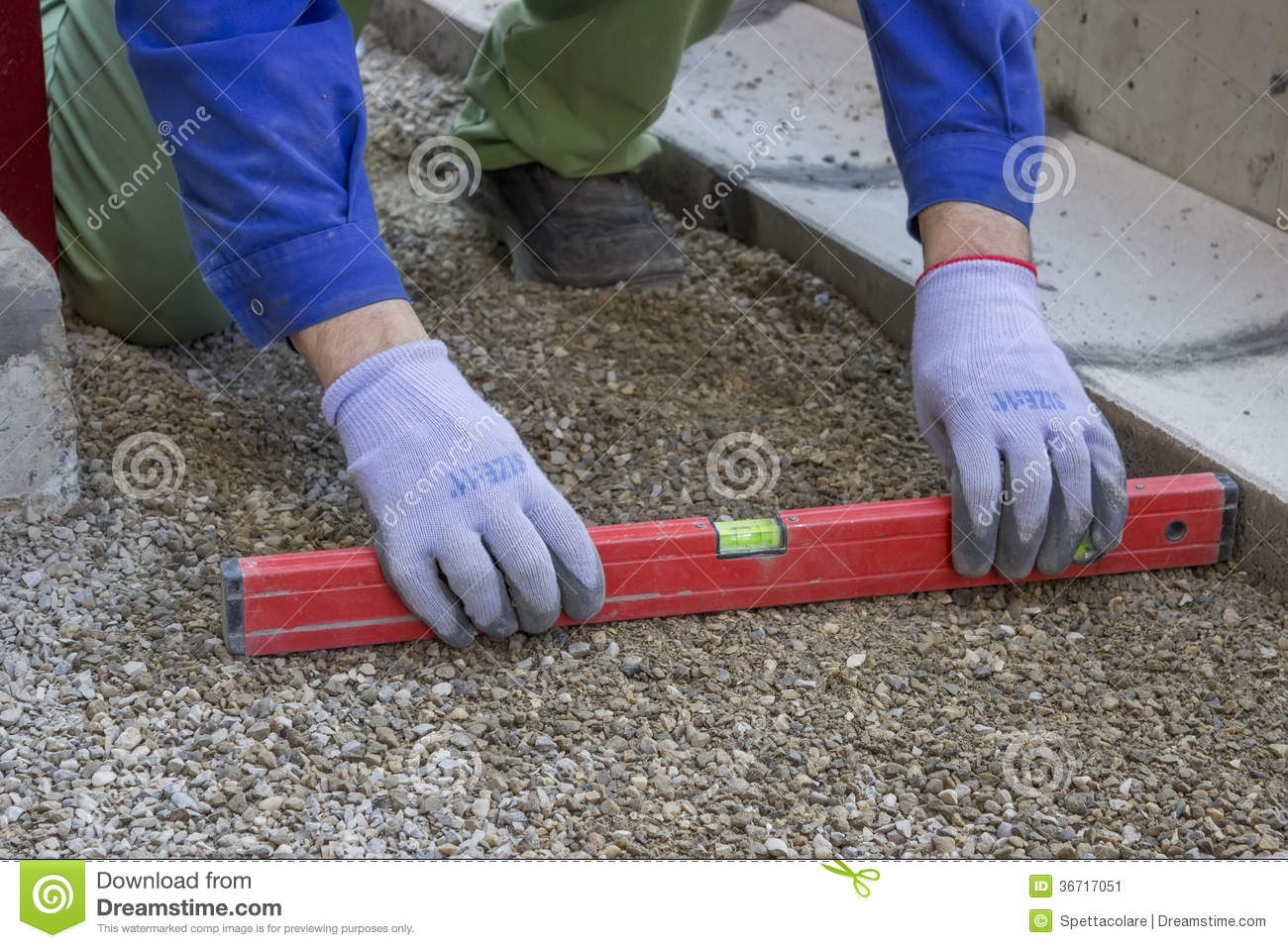 worker checking horizontal level of ground for paving stock image image 36717051. Black Bedroom Furniture Sets. Home Design Ideas