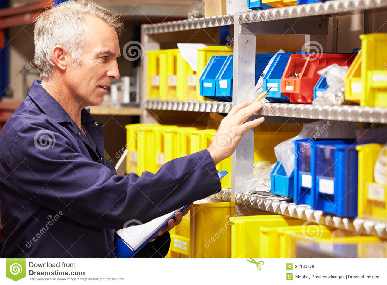 worker checking stock levels in store room stock image image worker checking stock levels in store room royalty stock image