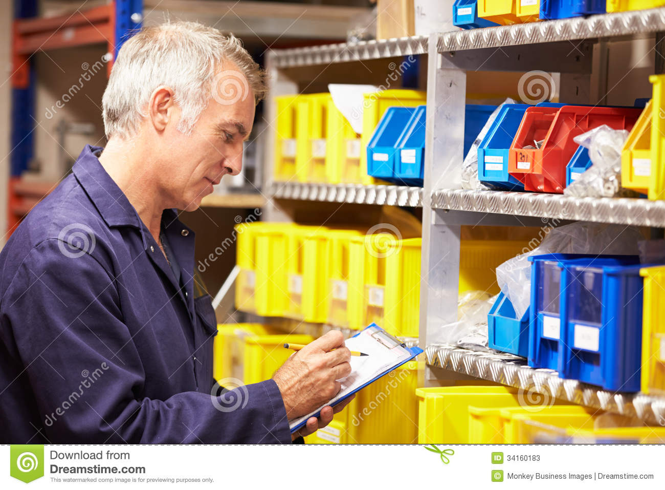 worker checking stock levels in store room stock photos image worker checking stock levels in store room