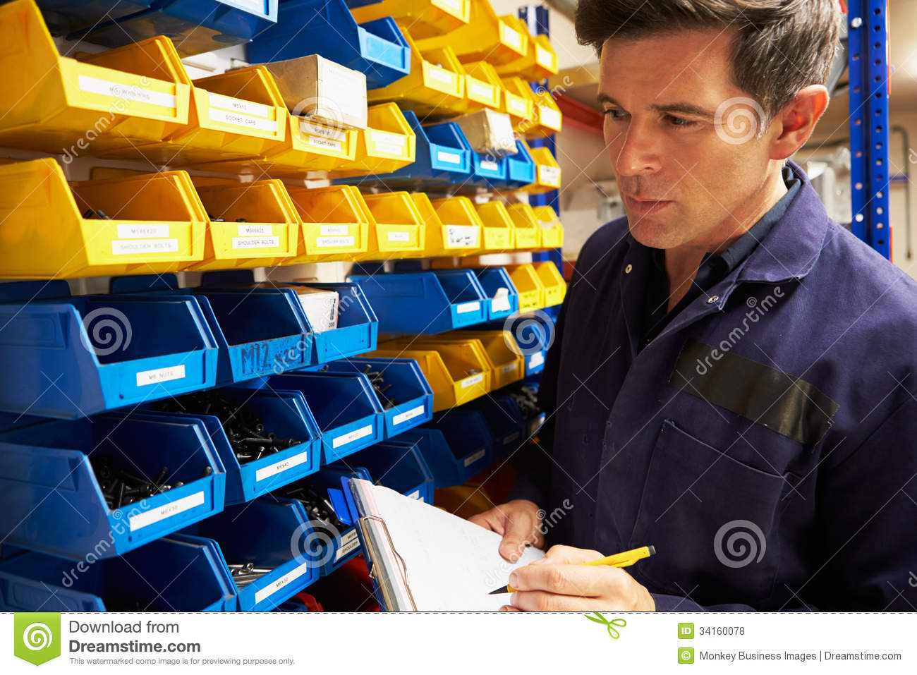 worker checking stock levels in store room stock image image worker checking stock levels in store room royalty stock photos