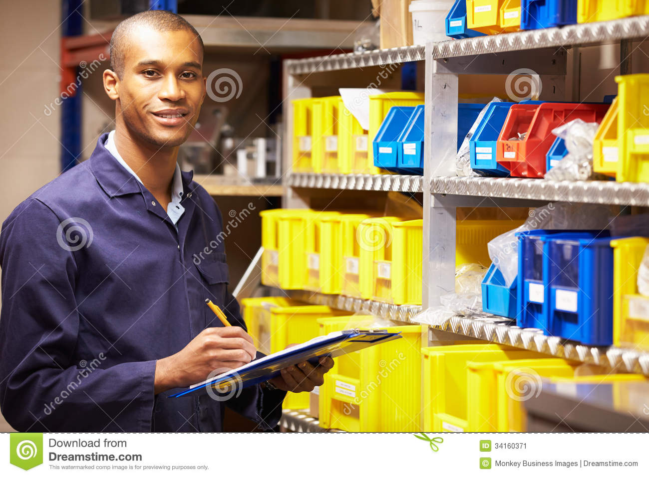 worker checking stock levels in store room stock image image worker checking stock levels in store room