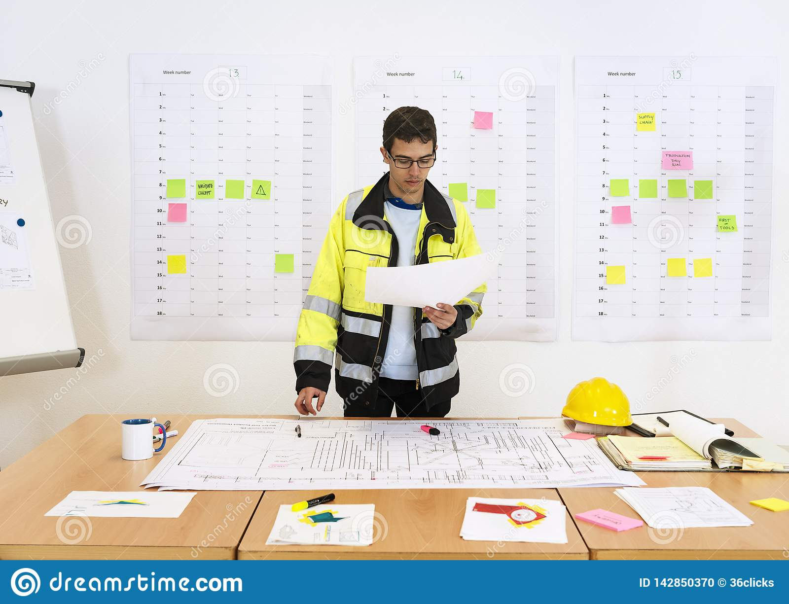 Worker checking technical drawings