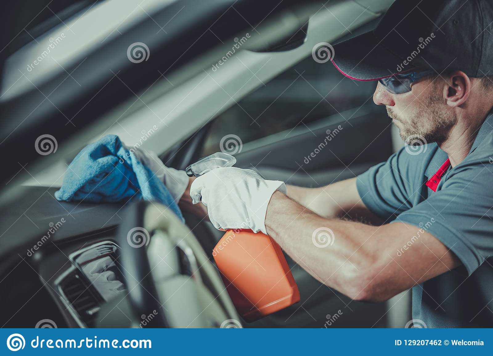 Worker cleaning car interior stock photo image of - Professional car interior cleaning ...