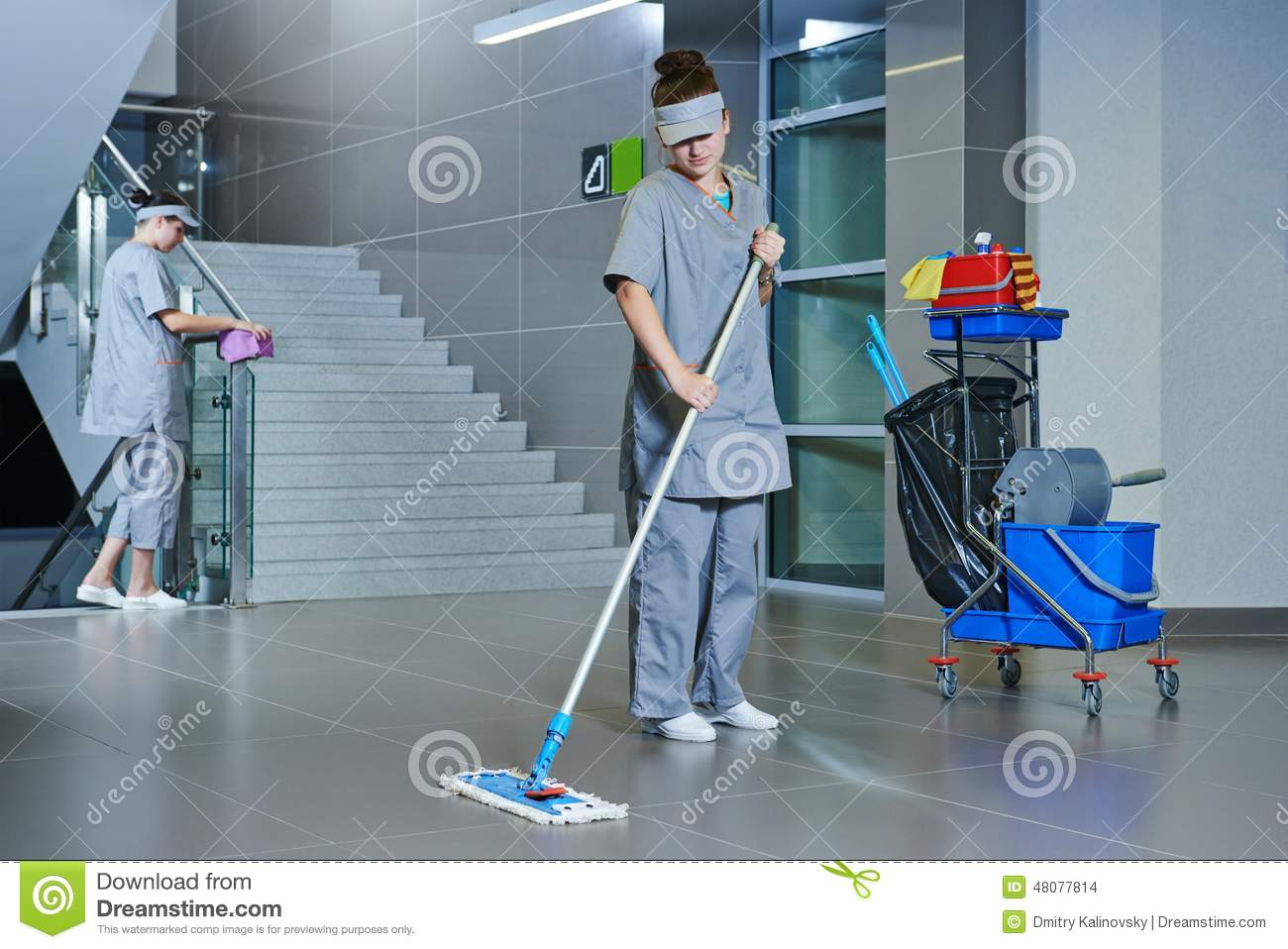 Worker cleaning floor with machine stock photo image for Floor cleaning services
