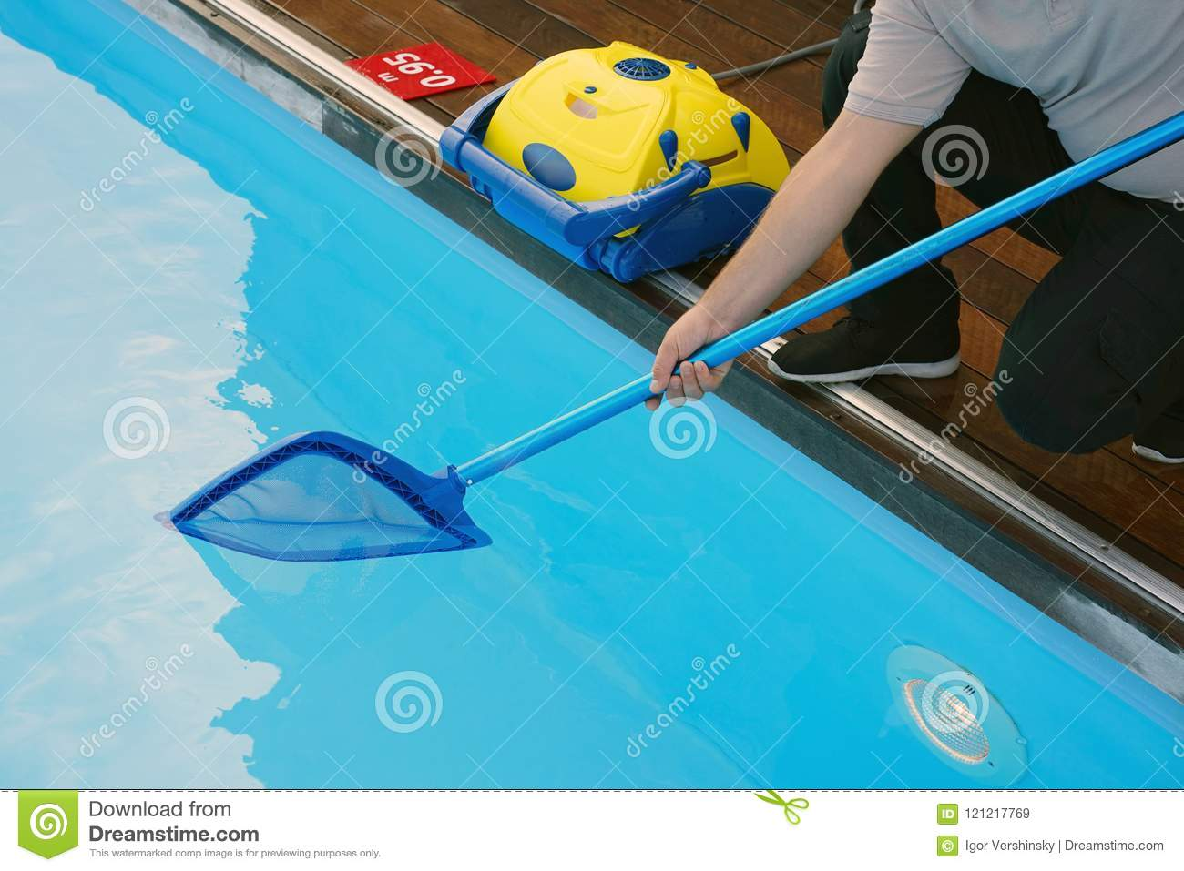 Worker Cleaning The Pool. Automatic Pool Cleaners. Stock Image ...