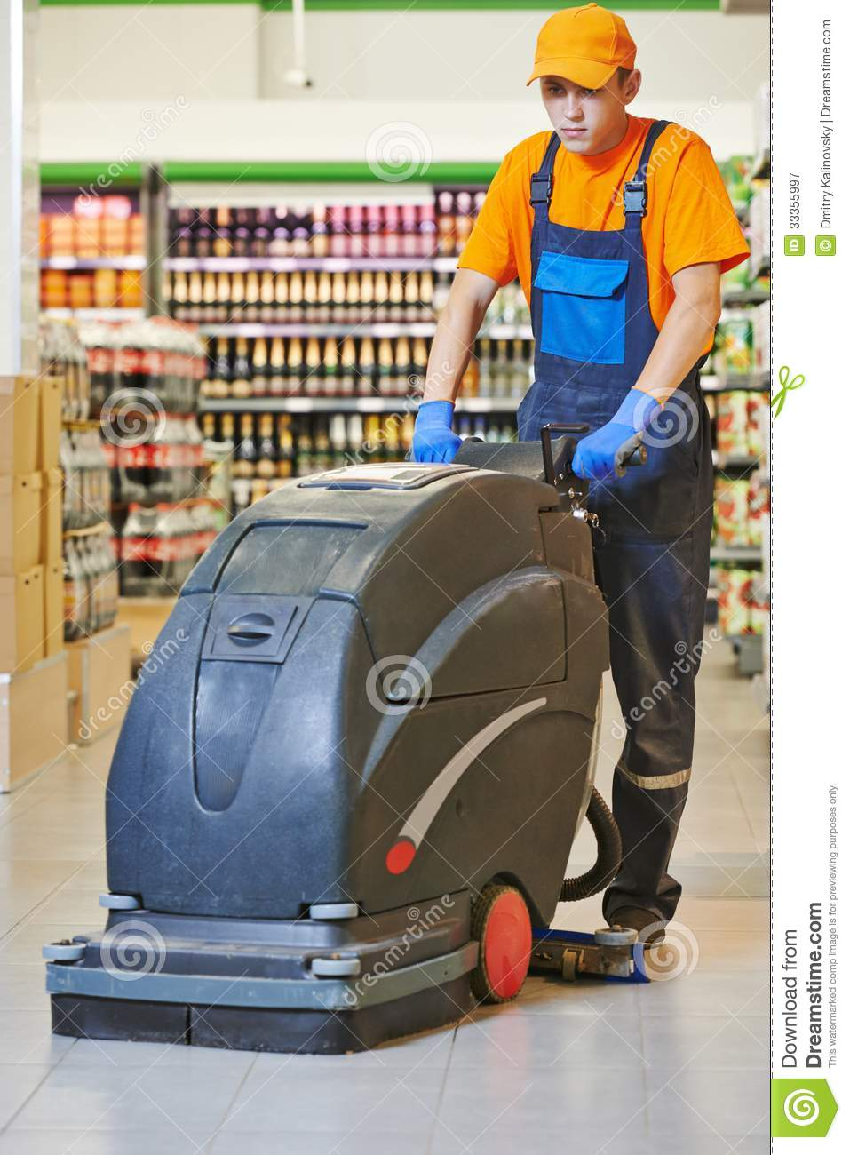 Worker cleaning store floor with machine royalty free for Floor cleaning services