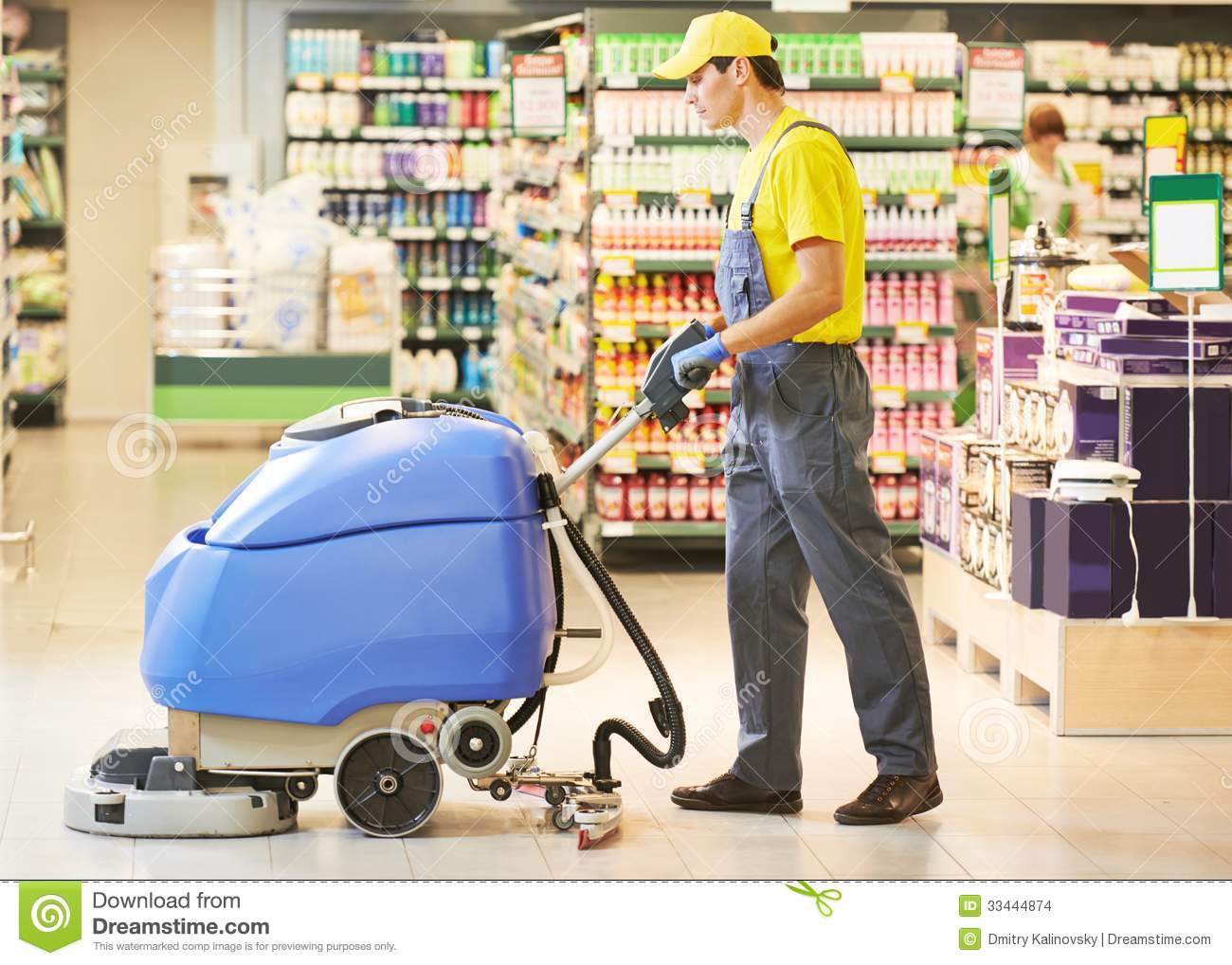 Worker Cleaning Store Floor With Machine Stock Images