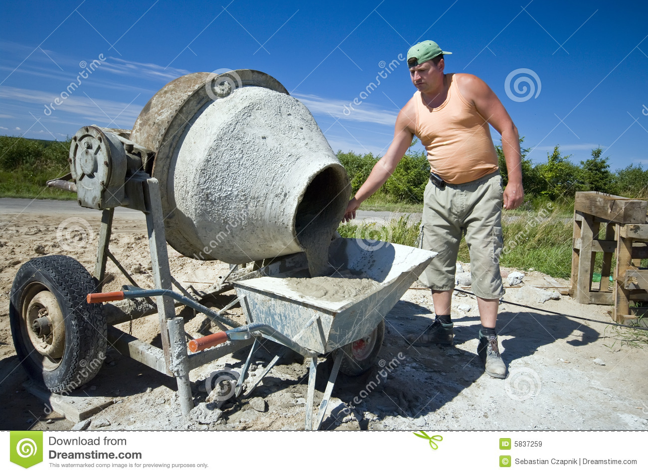 Concrete Mixing Animation : Worker and concrete mixer royalty free stock images