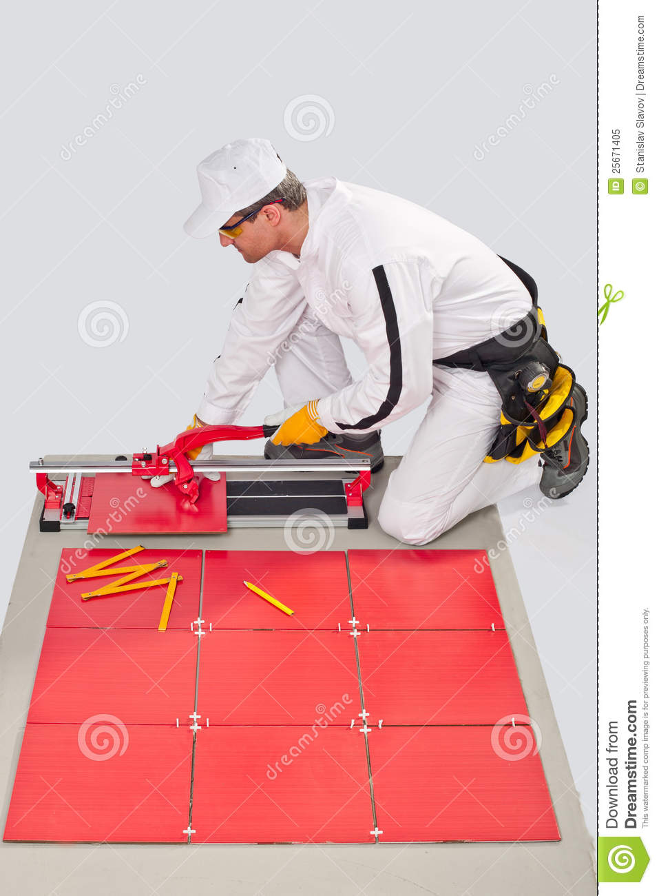 Worker cut ceramic tile machine stock image image of applicator worker cut ceramic tile machine dailygadgetfo Image collections