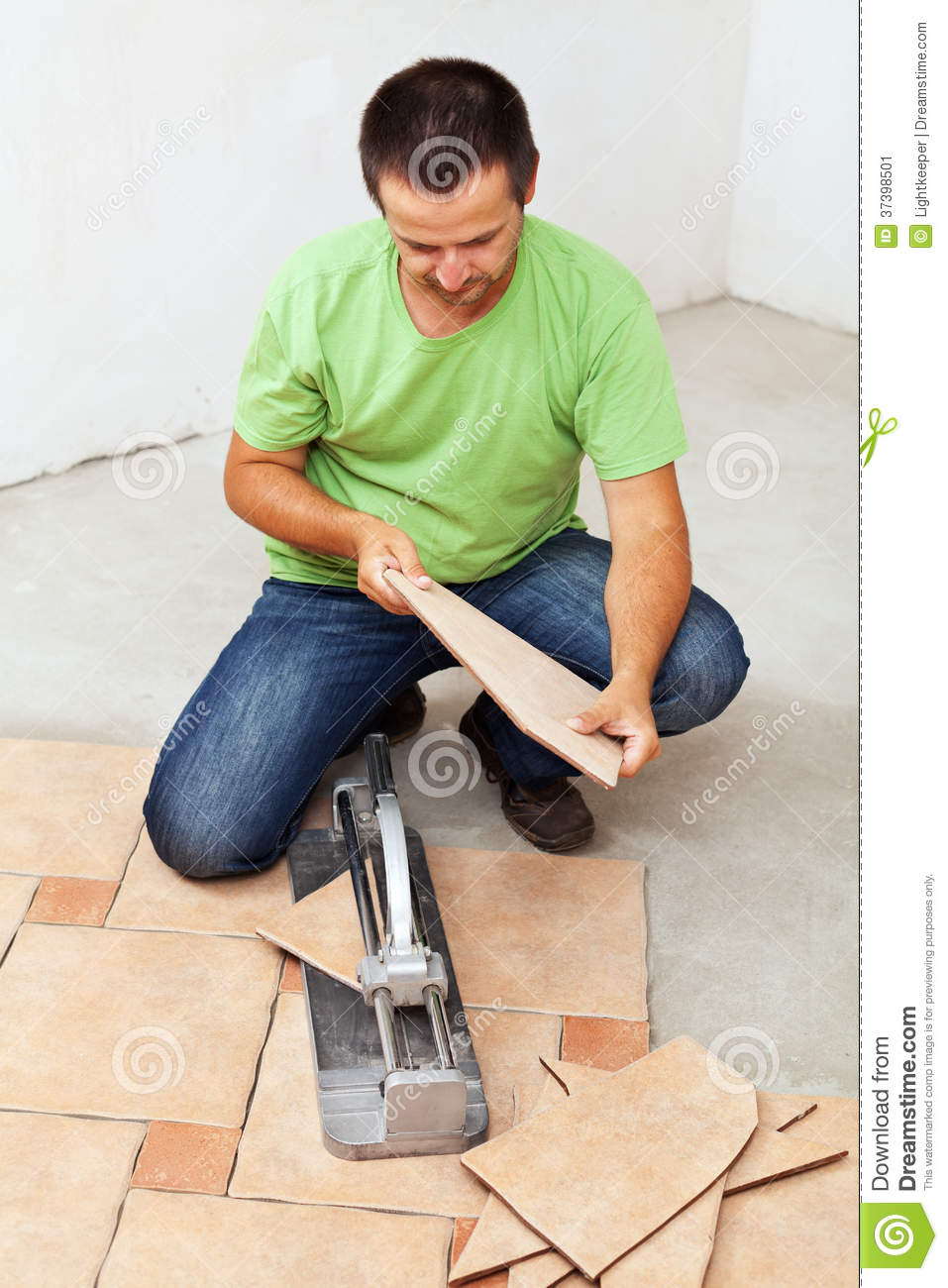 Floor Tile Workers : Worker hands laying ceramic floor tiles royalty free stock